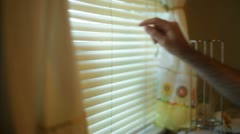 Looking window blinds spy spying look peeping peep Stock Footage