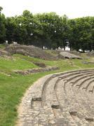 ancient rocks at roman theatre - stock photo