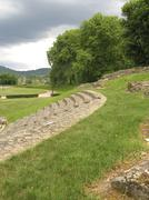 roman theatre next to soccer field - stock photo