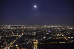 full moon over paris - stock photo