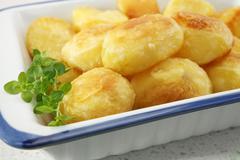 Crunchy roast potatoes Stock Photos