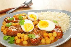 Moroccan north african middle eastern food lamb tagine eggs chickpeas Stock Photos