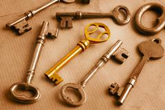 golden key and grunge - stock photo