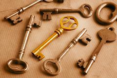 Golden key and grunge Stock Photos