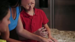 Mom and children baking cookies - stock footage