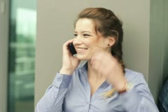Tree businesspeople with cellphones - happy, angry and depressed, steadycam shot Stock Footage