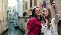 Female friends taking photo with cellphone in Venice, steadicam shot HD - stock footage
