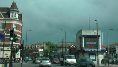 Driving through Tooting, London past underground station. Stock Footage