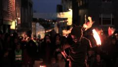 Man Fire Dancing (Twirling, Spinning) in the Street an Night - Slow Pan 2 HD Stock Footage
