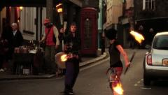 Fire Dancing (Twirling, Spinning) in the Street at Dusk 2 - Static HD Stock Footage