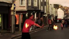Man Fire Dancing (Twirling, Spinning) in the Street at Dusk HD Stock Footage