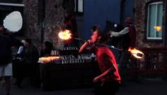 Man Fire Dancing (Twirling, Spinning) in the Street - Static 2 HD Stock Footage