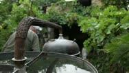 Traditional distillation of rakia (setting up the equipment)_4 Stock Footage