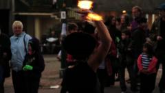 Woman Fire Dancing (Twirling, Spinning) in Street  - Static HD Stock Footage