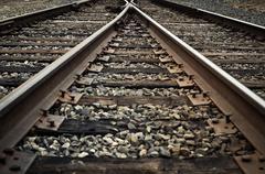 Old rustic railroad track splitting lanes Stock Photos