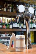 Beer faucet with a mug in a bar Stock Photos