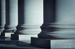 Pillars of law and education Stock Photos
