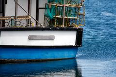 A white blue fishing boat Stock Photos