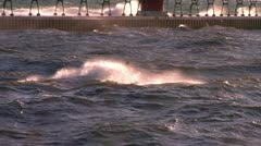 Man on a jet-ski in Grand Haven inlet during gale Stock Footage