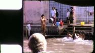 Stock Video Footage of THAIS BATHING Riverside Bangkok Circa 1970 (Vintage Film Home Movie) 4263