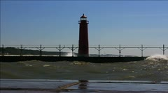Waves crashing onto Grand Haven lighthouse during September gale Stock Footage