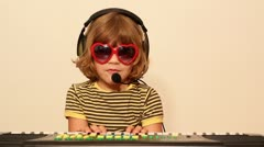 little girl with sunglasses play music - stock footage
