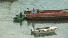 Greenland Qaqortoq kids and boat p Stock Footage