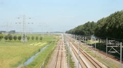 Train driving in the countryside from the Netherlands Stock Footage