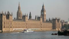 Houses of Parliament angled wide with boat - stock footage