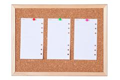 isolated corkboard with blank paper notes - stock photo