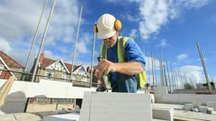 Bricklayer on construction site - stock footage