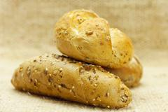 bread with seeds  in a wicker mat - stock photo