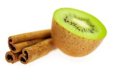 Kiwi and cinnamon isolated on white Stock Photos