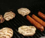 Stock Video Footage of Flipping Turkey Burgers on Grill