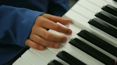 Learning the piano Stock Footage