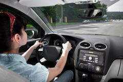 women driving a car - stock photo
