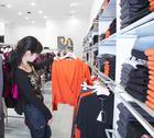 Girl and shop Stock Photos