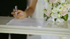 signing the register - stock footage