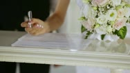 Stock Video Footage of signing the register