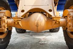 excavator axles, wheels - stock photo