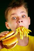child and fast food. - stock photo