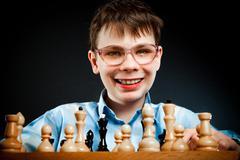 nerd play chess - stock photo