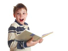 the boy with the book - stock photo