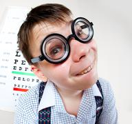 Person wearing spectacles in an office at the doctor Stock Photos