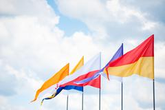 Triangular flags in wind Stock Photos