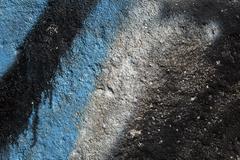 Graffiti on a grainy concrete wall Stock Photos