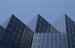 Triangular shape of an office building - stock photo