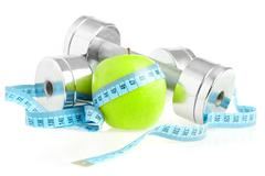 dumbbells and apple. a healthy way of life - stock photo