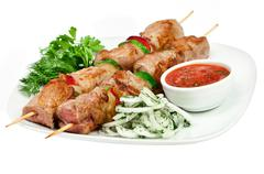 Tasty grilled meat, shish kebab Stock Photos