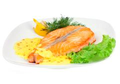 tasty fillet of a salmon on a white - stock photo